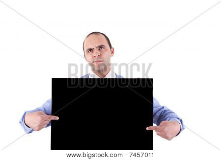 Young Business Man Holding A Blackboard And Pointing With Both Hands, Looking Bored