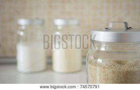 Three Containers With Breadcrumbs, Flour, Semolina