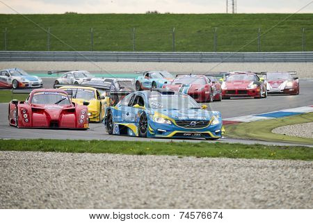 ASSEN, NETHERLANDS - OCTOBER 19: The GT and GT2 field races through the chicane, during the first lap of the final races of the European Acceleration tour of the Supercar challenge