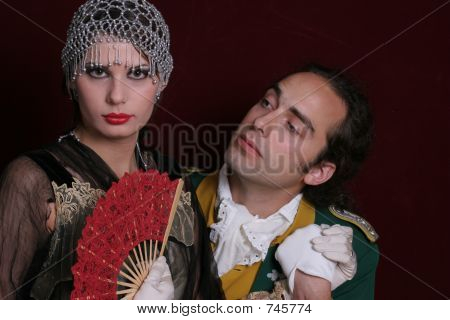 Men and girl in mascarade dresses