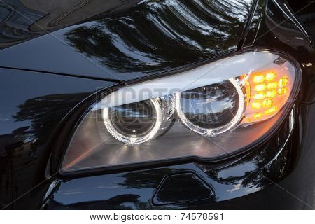 KIEV, UKRAINE - JULY 27, 2012: Headlights of a 7 series BMW car