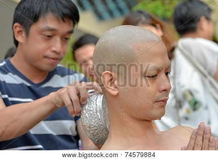 An Thai Male Sit For  Ordain Ritual With His Family