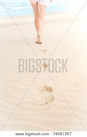 Slim Girl In White Swimsuit Walking To Ocean.