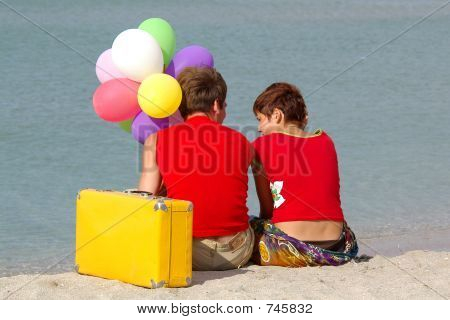 Two Person On The Beach With Colored Balloons