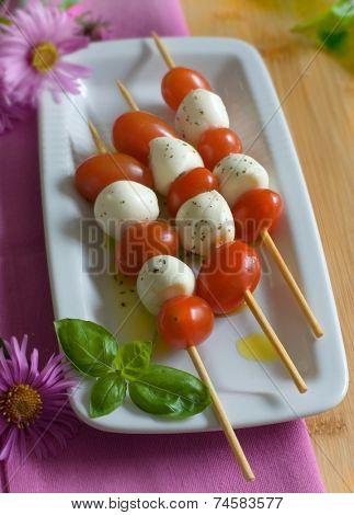 fresh bocconcini mozzarella and cherry tomatos on skewers