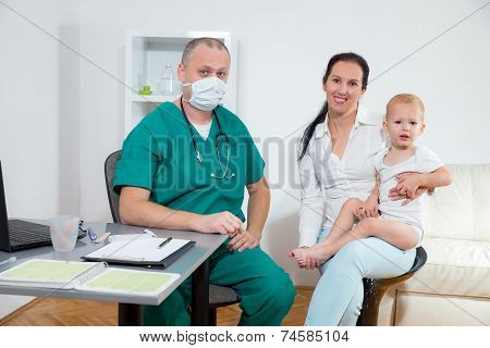 Baby being checked by a doctor