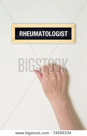 Female Hand Is Knocking On Rheumatologist Door