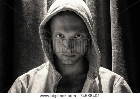Black And White Portrait Of Man In Hood