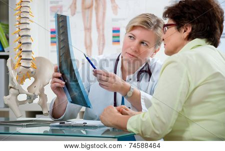 Doctor explaining x-ray results to patient