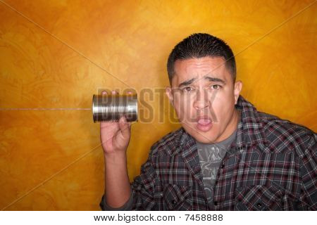 Hispanic Man With Tin Can Telephone