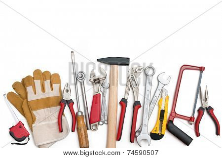 Assorted building tools over a white background
