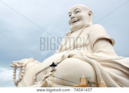 Happy Buddha with beads in Vietnam