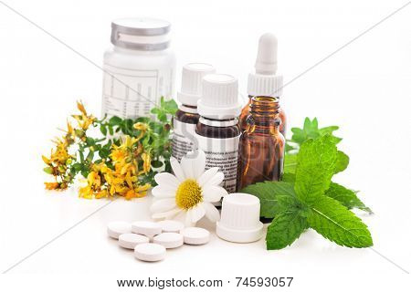 Healing herbs and medicinal bottles. Alternative medicine concept