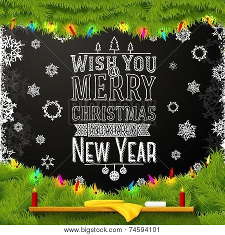 Wish you a merry christmas and happy new year message, written on the school chalkboard. Decorated w