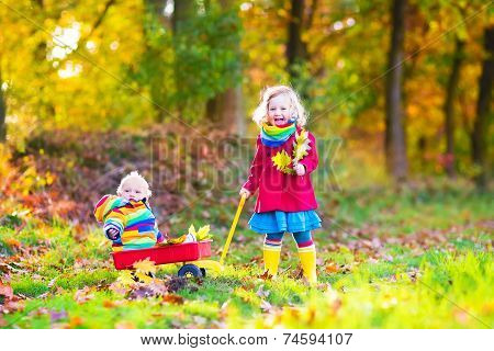 Brother And Sister In An Autumn Park