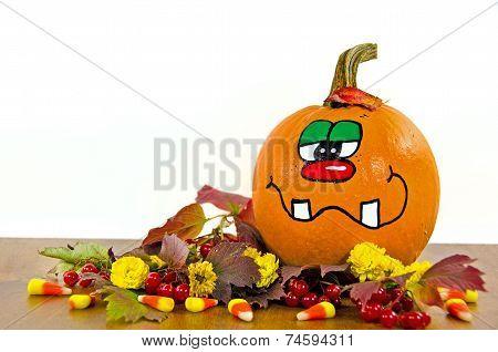 funny face on autumn pumpkin