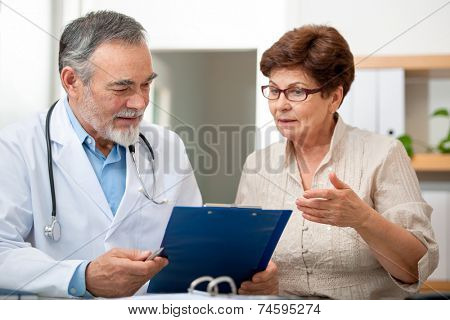 doctor talking to his female patient at office