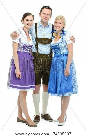 group of young people in traditional bavarian tracht isolated on white