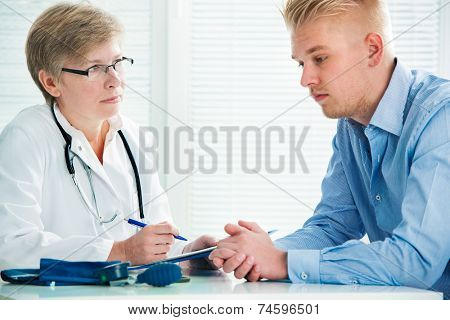 Young man visits doctors office suffering with depression