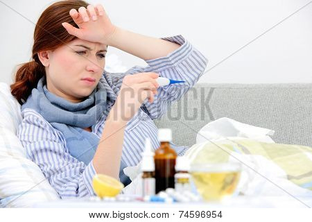 Sick woman  lying in bed with high fever. Cold, flu, fever and migraine