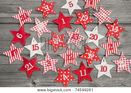 Advent calendar with stars on old wooden background