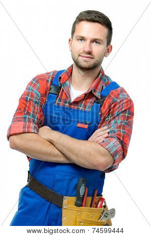 Handsome young handyman with arms crossed isolated on white background