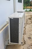 stock photo of air compressor  - Compressor of air condition are outside building office - JPG
