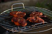 stock photo of barbie  - Four steaks barbecue on grill close up  - JPG