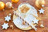 stock photo of yule  - Eggnog with cinnamon and homemade christmas cookies with sugar frosting - JPG
