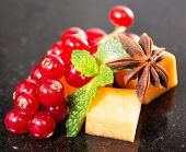 picture of fruit platter  - Assortment of delicious cheese and fruits on black - JPG