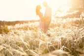 foto of country girl  - couple kiss at sunset - JPG