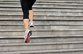 picture of stepping stones  - sports woman legs running up on stone stairs - JPG