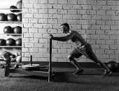image of lifting weight  - sled push man pushing weights workout exercise - JPG