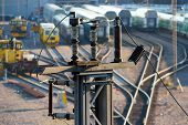 stock photo of railroad yard  - High voltage electricity insulators on railroad yard in Helsinki Finland - JPG