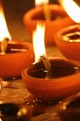 picture of pooja  - illuminating oil lamps close up in diwali festival