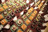 stock photo of catering  - Varieties of cakes individual decorative desserts on the table at a luxury event gourmet catering sweets - JPG