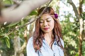 stock photo of filipina  - Pinoy woman in a green garden on farm - JPG