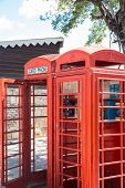 image of phone-booth  - Two old red phone booths in a park - JPG