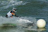 someone riding a jetski poster