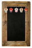 stock photo of wooden pallet  - Chalkboard christmas restaurant menu board reclaimed pallet wooden frame and shabby chic tin bells decoration isolated on white with copy space - JPG