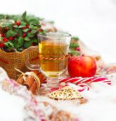 image of blanket snow  - Christmas still life with a Christmas decorations and hot tea nestling in fresh snow - JPG