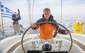image of yacht  - Young man sailing in the Sea - JPG