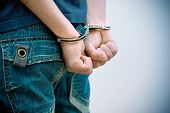 foto of handcuffed  - Young man in handcuffs - JPG