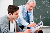 stock photo of motivation talk  - teacher with a group of high school students  in classroom - JPG