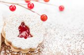 pic of linzer  - Christmas Linzer cookie decorated with powdered icing sugar and red Jam. Copy Space.