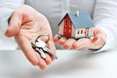 picture of ring  - Real estate agent with house model and keys - JPG