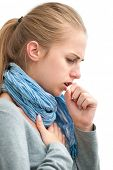 stock photo of cough  - portrait of an young woman coughing with fist - JPG