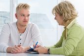 stock photo of empathy  - Teenager having a  therapy session while therapist is taking notes - JPG