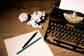 picture of outdated  - Vintage typewriter and a blank sheet of paper - JPG