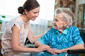 stock photo of granddaughters  - Senior woman with her caregiver at home - JPG